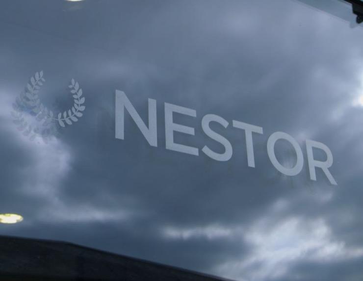 Nestor logo on glass